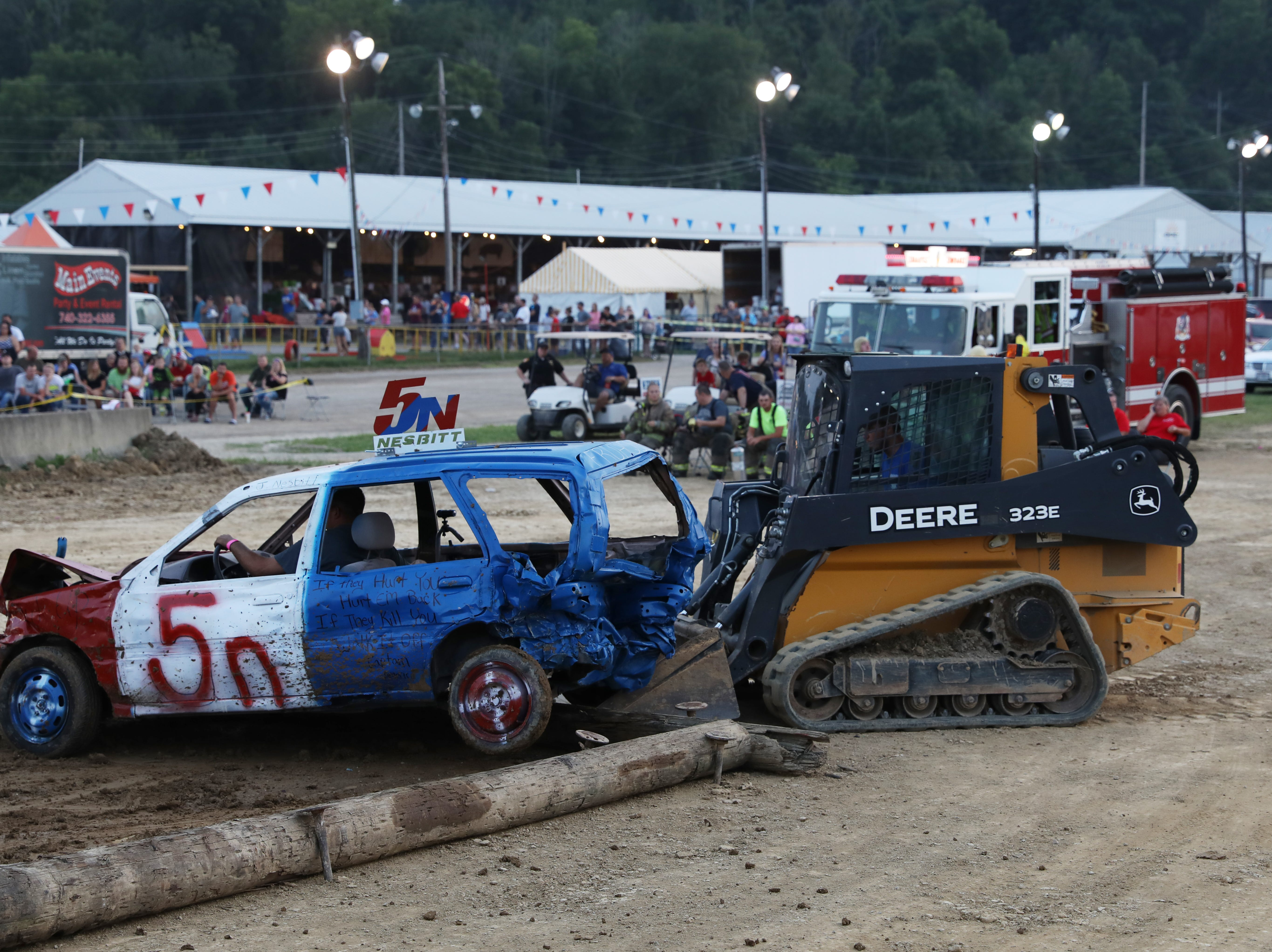 Jame Nesbitt gets a little help at the end of the first heat of the Sarge and Sons Demolition Derby on Wednesday.