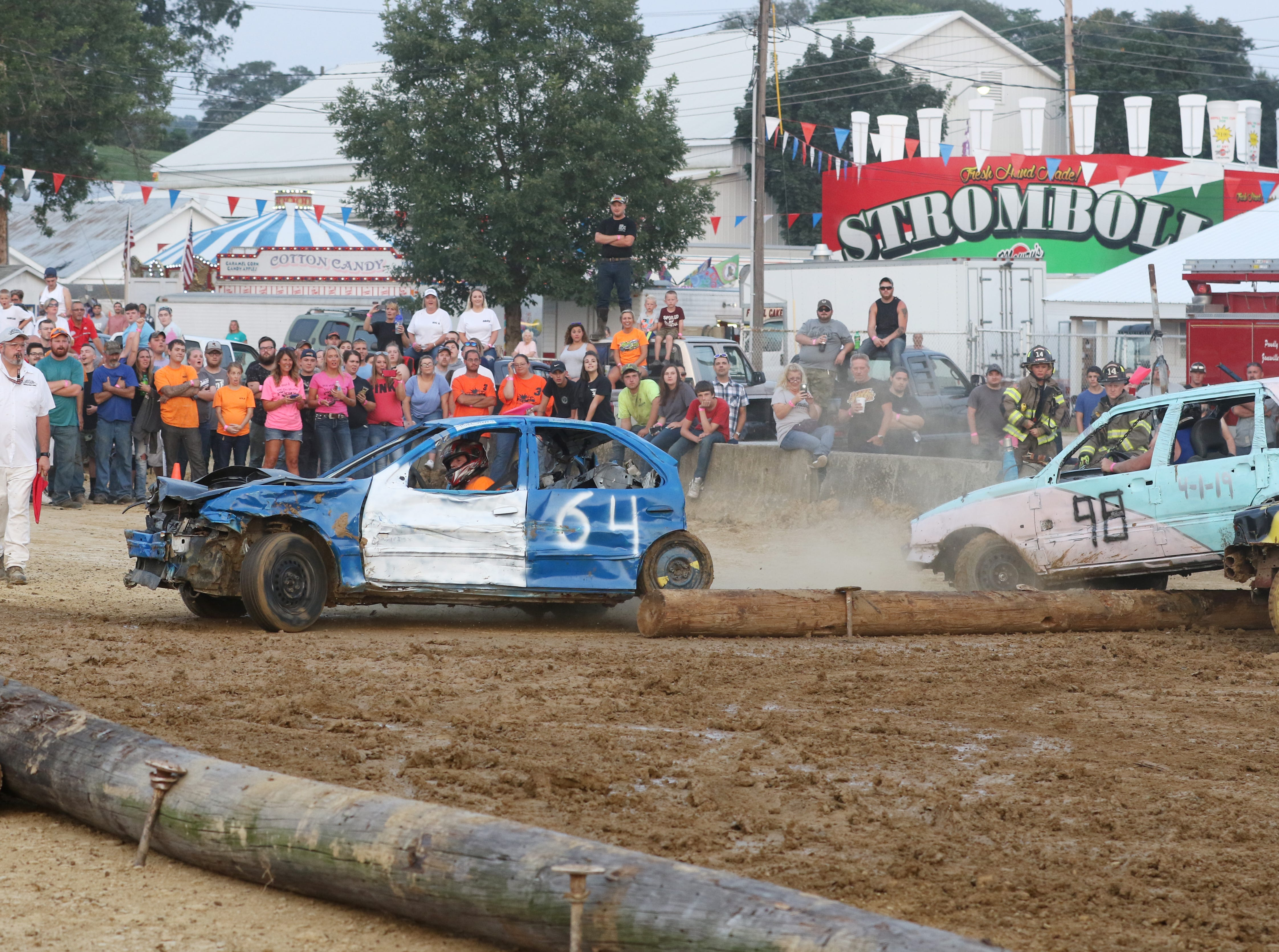 Mike Steppg finds himself on the wrong side of the poles that make up the track during the Sarge and Sons Demolition Derby at the Muskingum County Fair on Tuesday.
