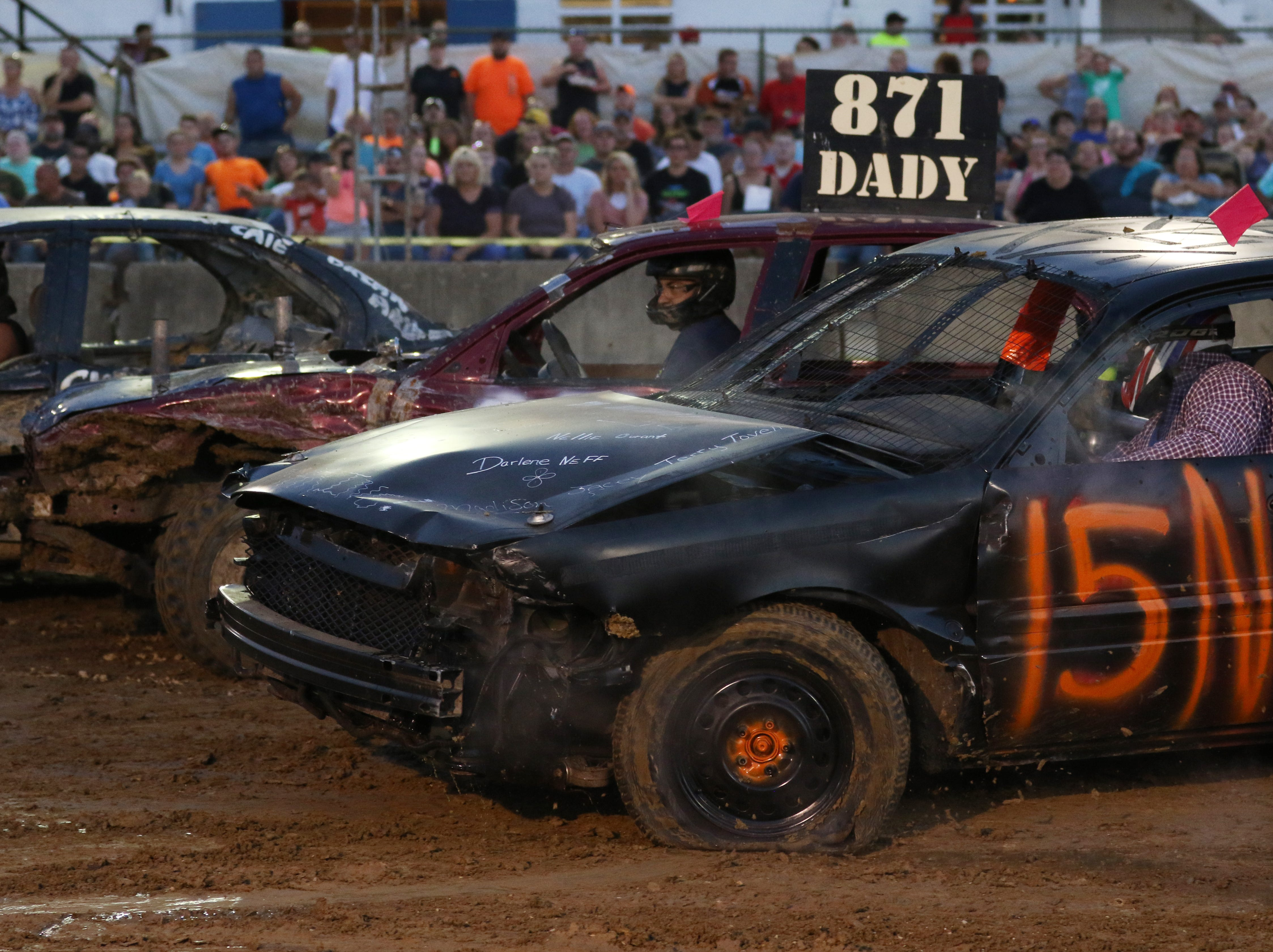 Sam Neff in the 15n car looks for someone to hit during the Sarge and Sons Demolition Derby at the Muskingum County Fair on Tuesday.