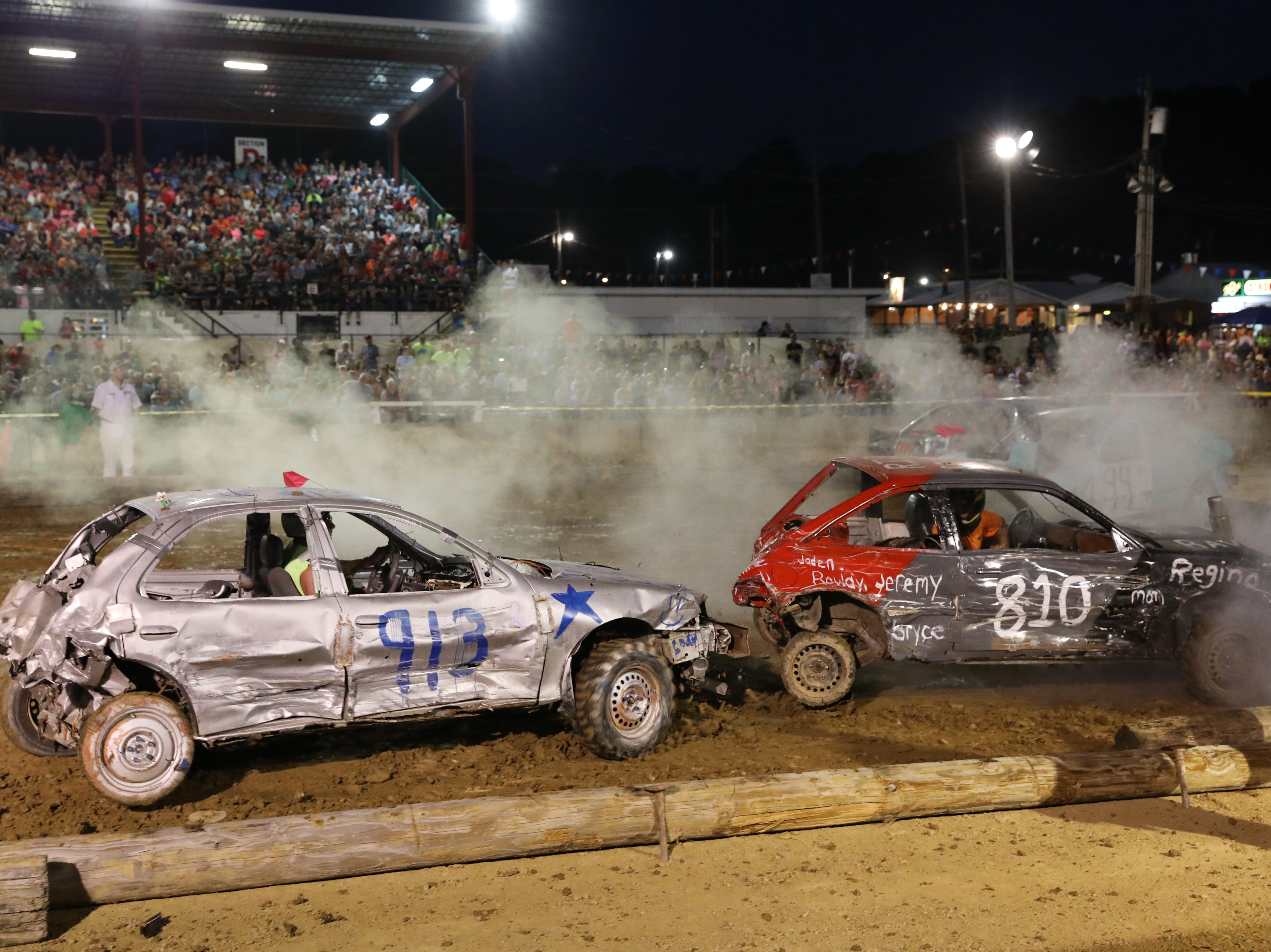 Robert Anderson's 810 car and Brian Paul's 913 battle to the end of the third heat during the Sarge and Sons Demolition Derby at the Muskingum County Fair on Tuesday.