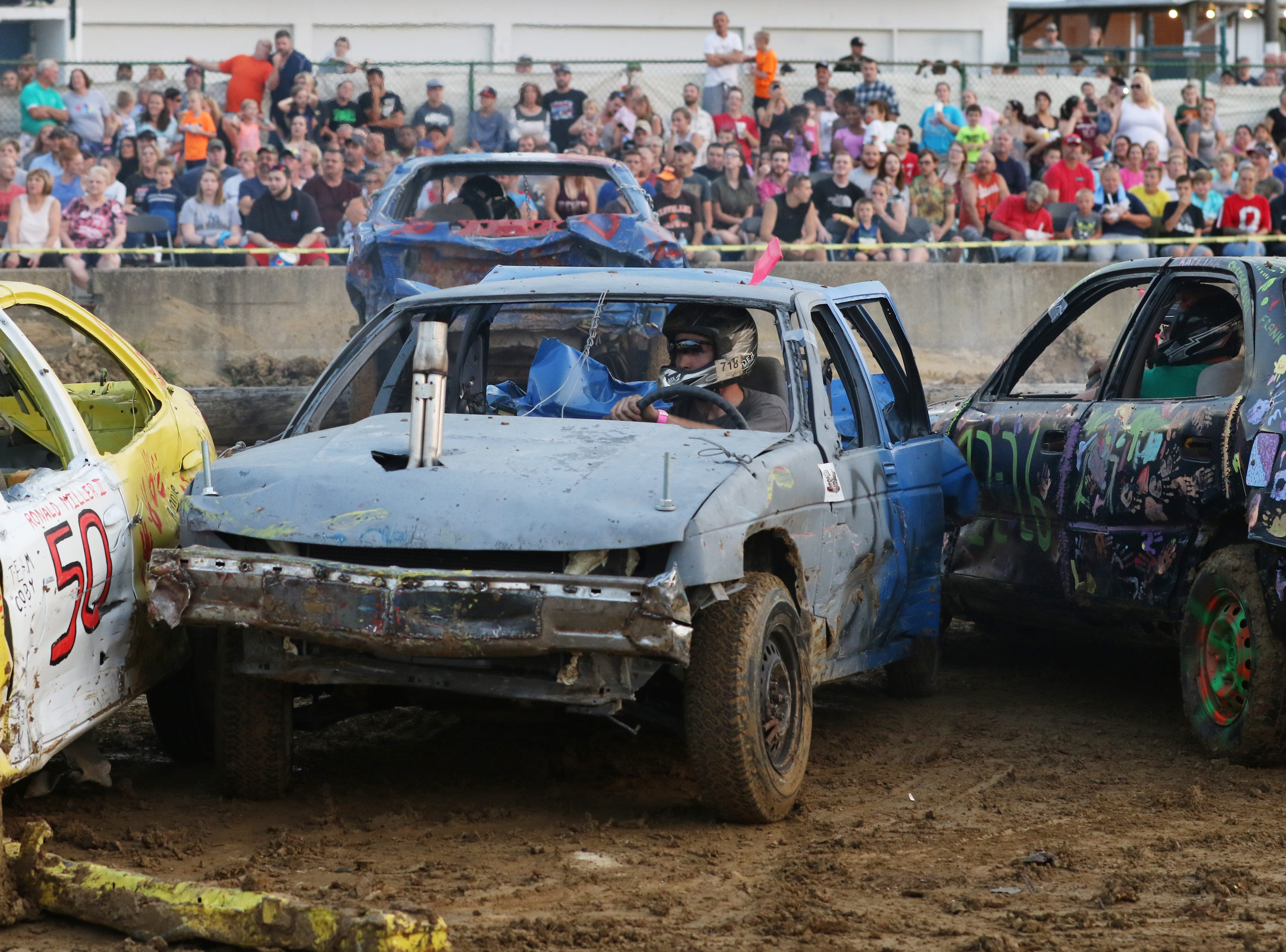 Scott Cordle is sandwiched during the Sarge and Sons Demolition Derby at the Muskingum County Fair on Tuesday.