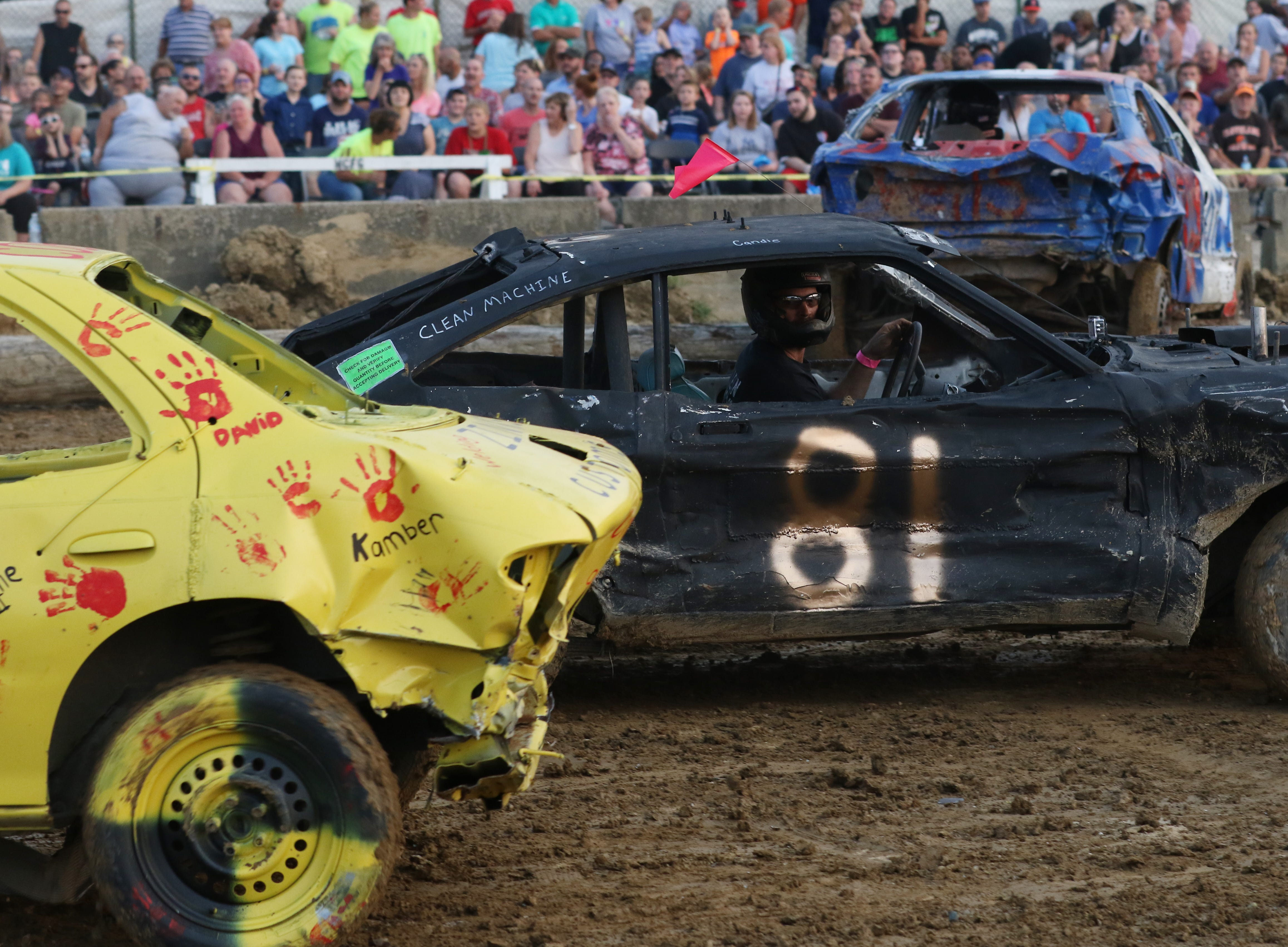 Dusty Dady in his 81 car looks for someone to hit during the Sarge and Sons Demolition Derby at the Muskingum County Fair on Tuesday.