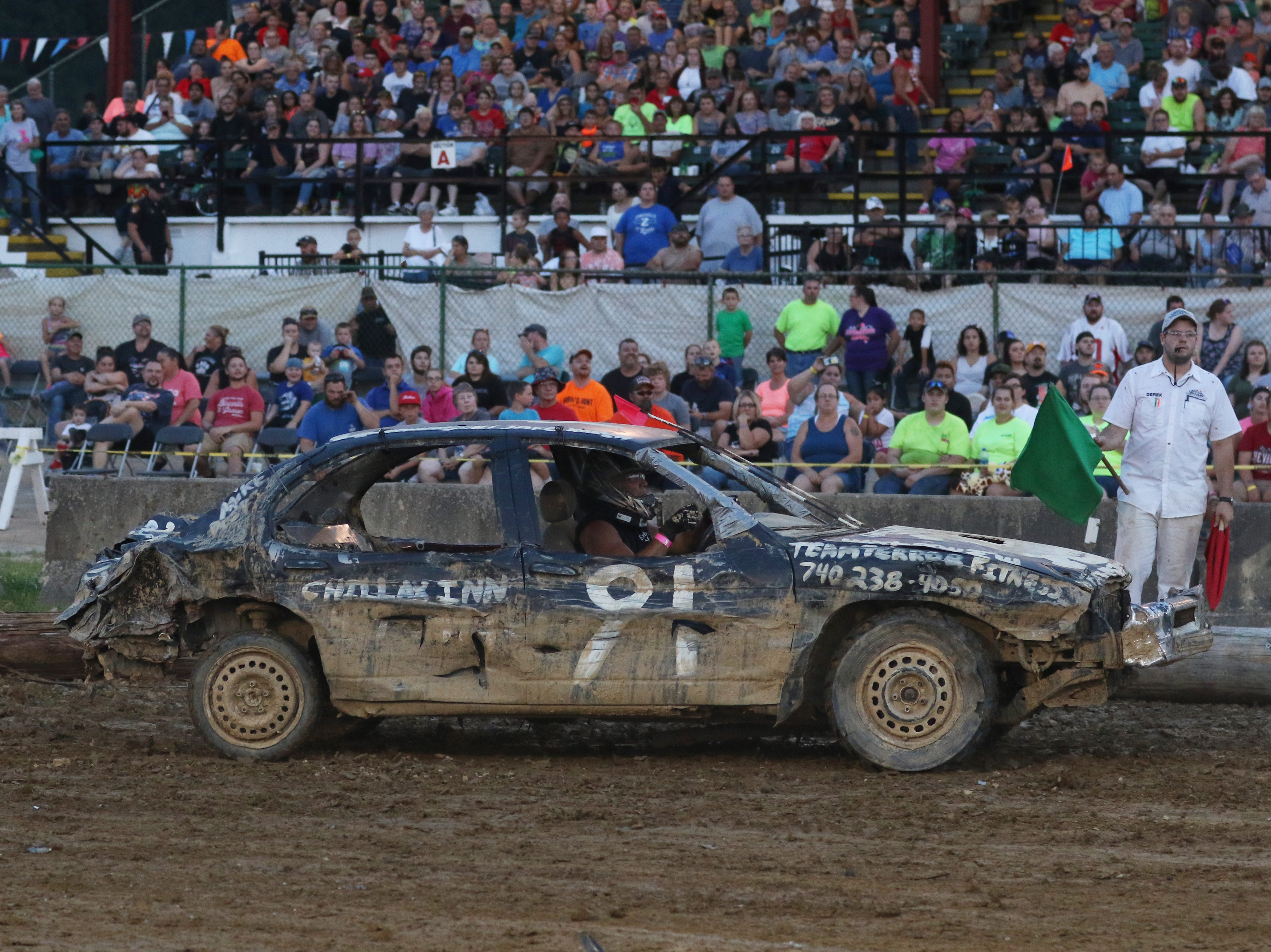 Doug Fisher looks for someone to hit during the Sarge and Sons Demolition Derby at the Muskingum County Fair on Tuesday.