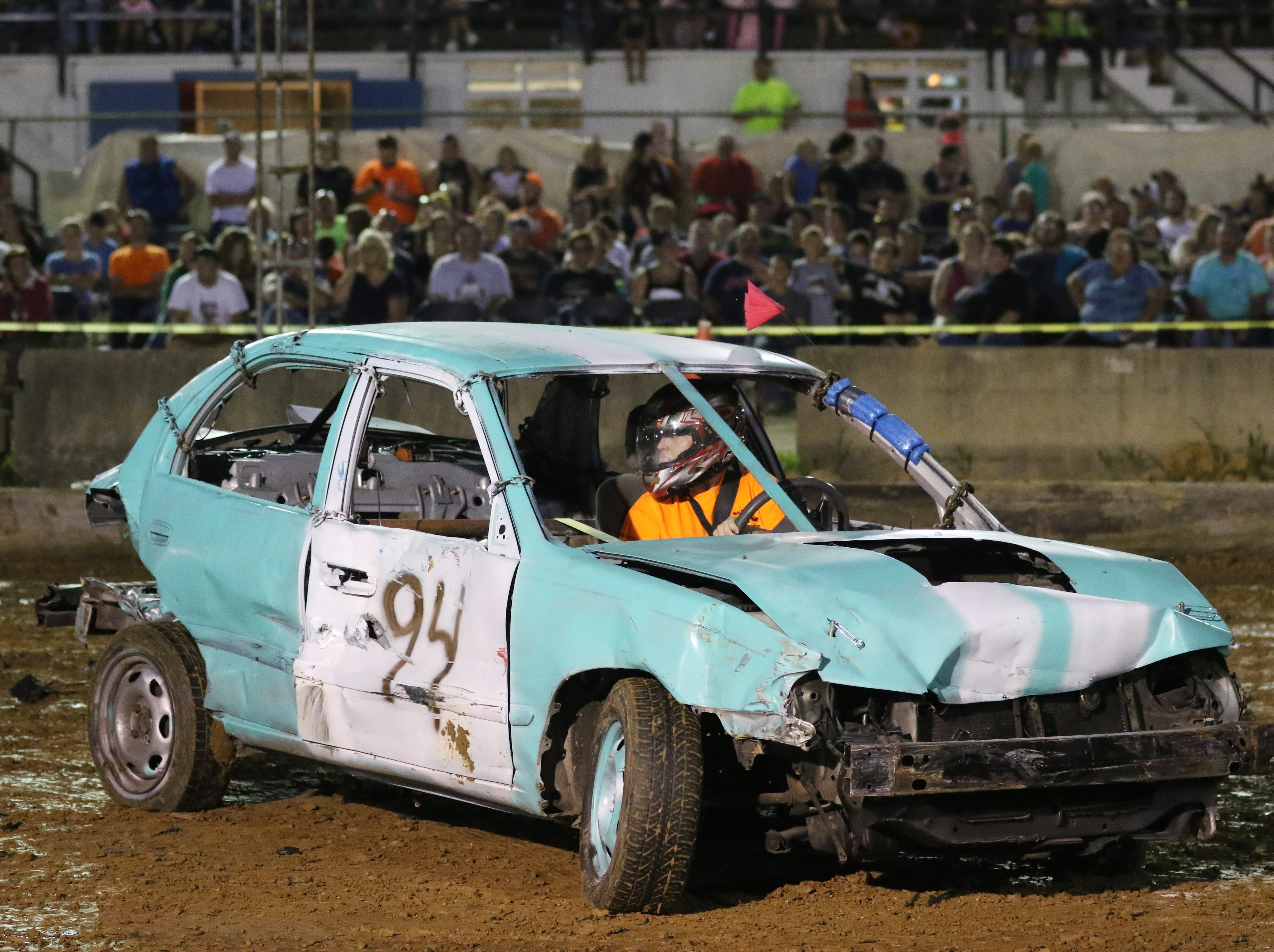 Taylor Ellis looks for someone to hit during the Sarge and Sons Demolition Derby at the Muskingum County Fair on Tuesday.