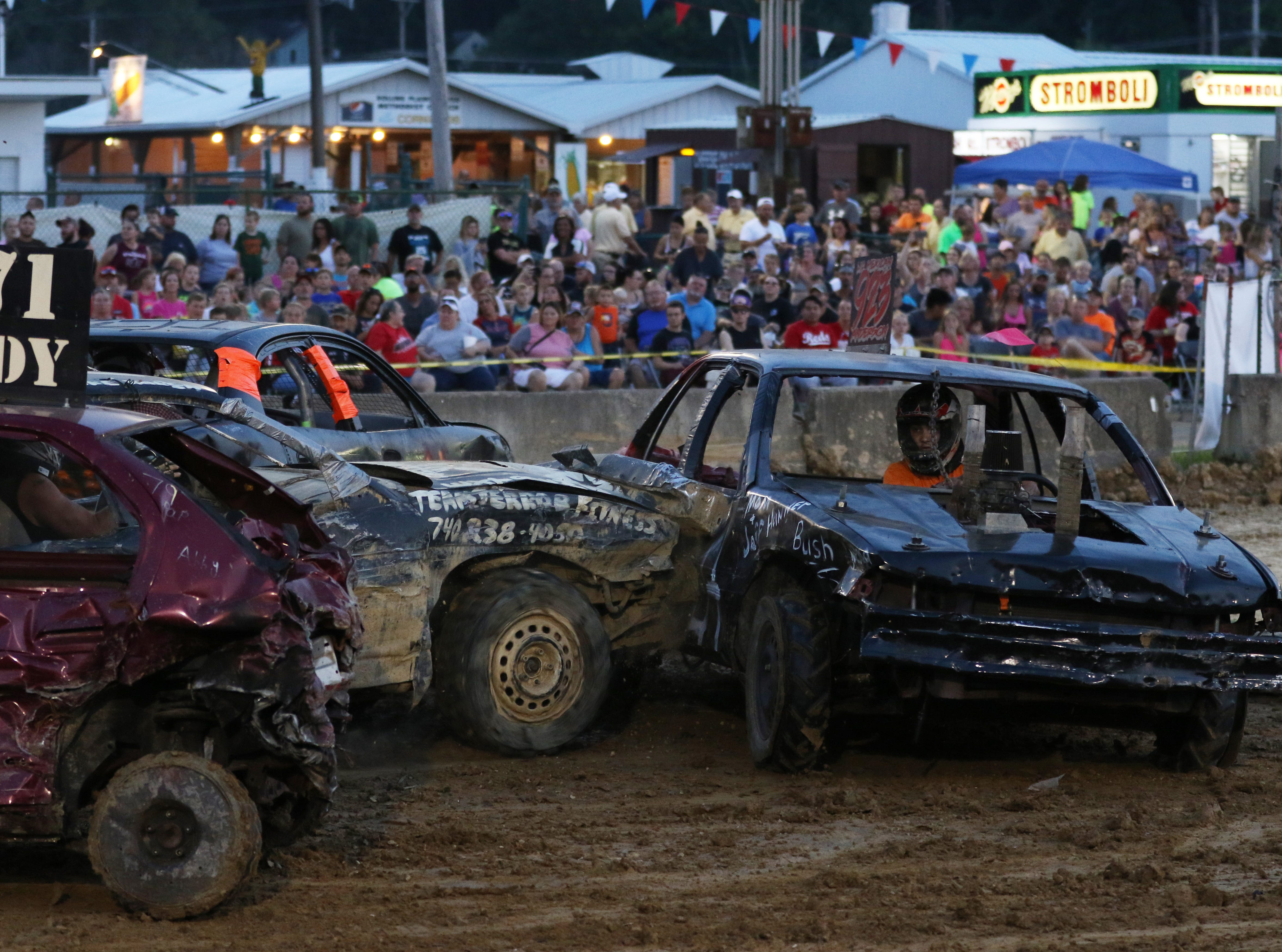 Aaron Anderson gets hit during the Sarge and Sons Demolition Derby at the Muskingum County Fair on Tuesday.