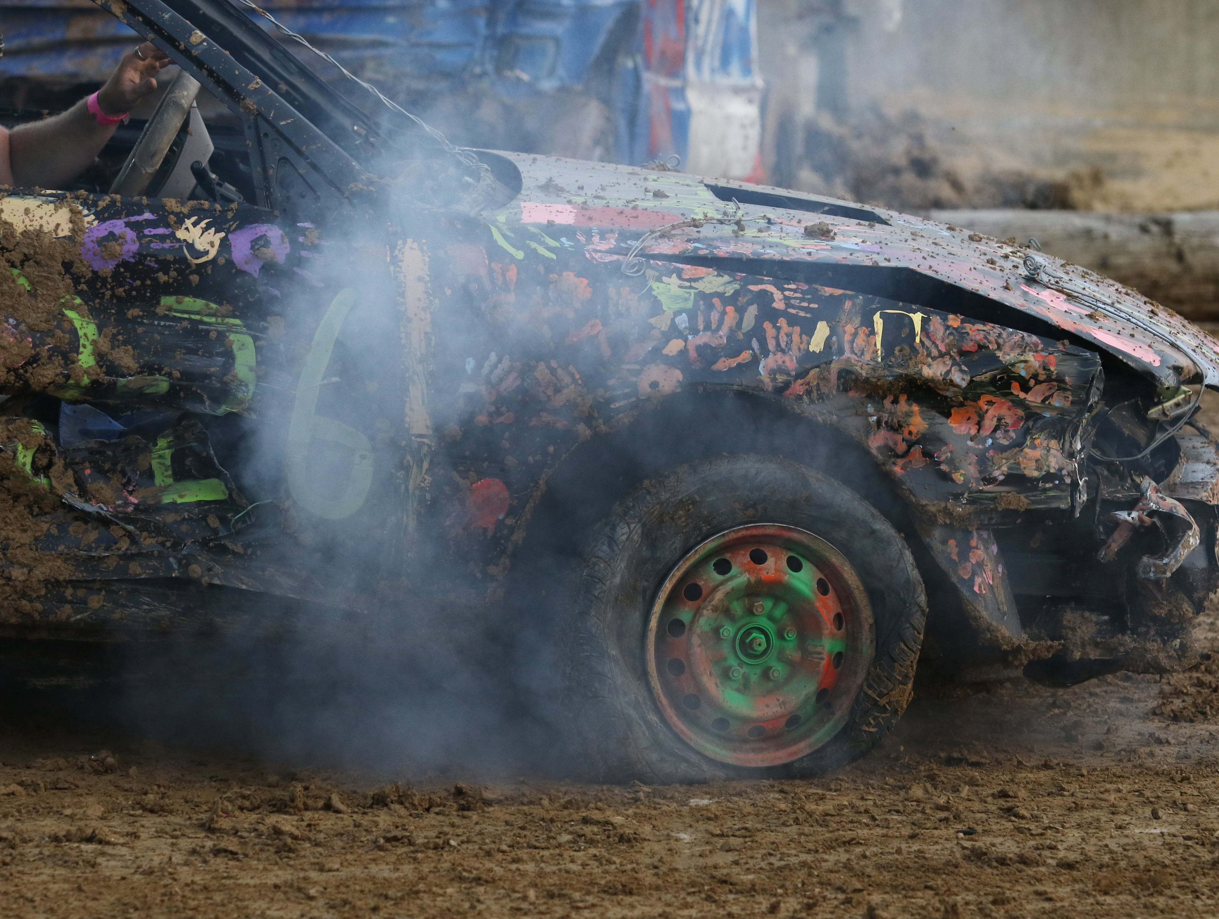 Jimmy Gibson's 1226 car is worse for wear in the early goings of the Sarge and Sons Demolition Derby at the Muskingum County Fair on Tuesday.