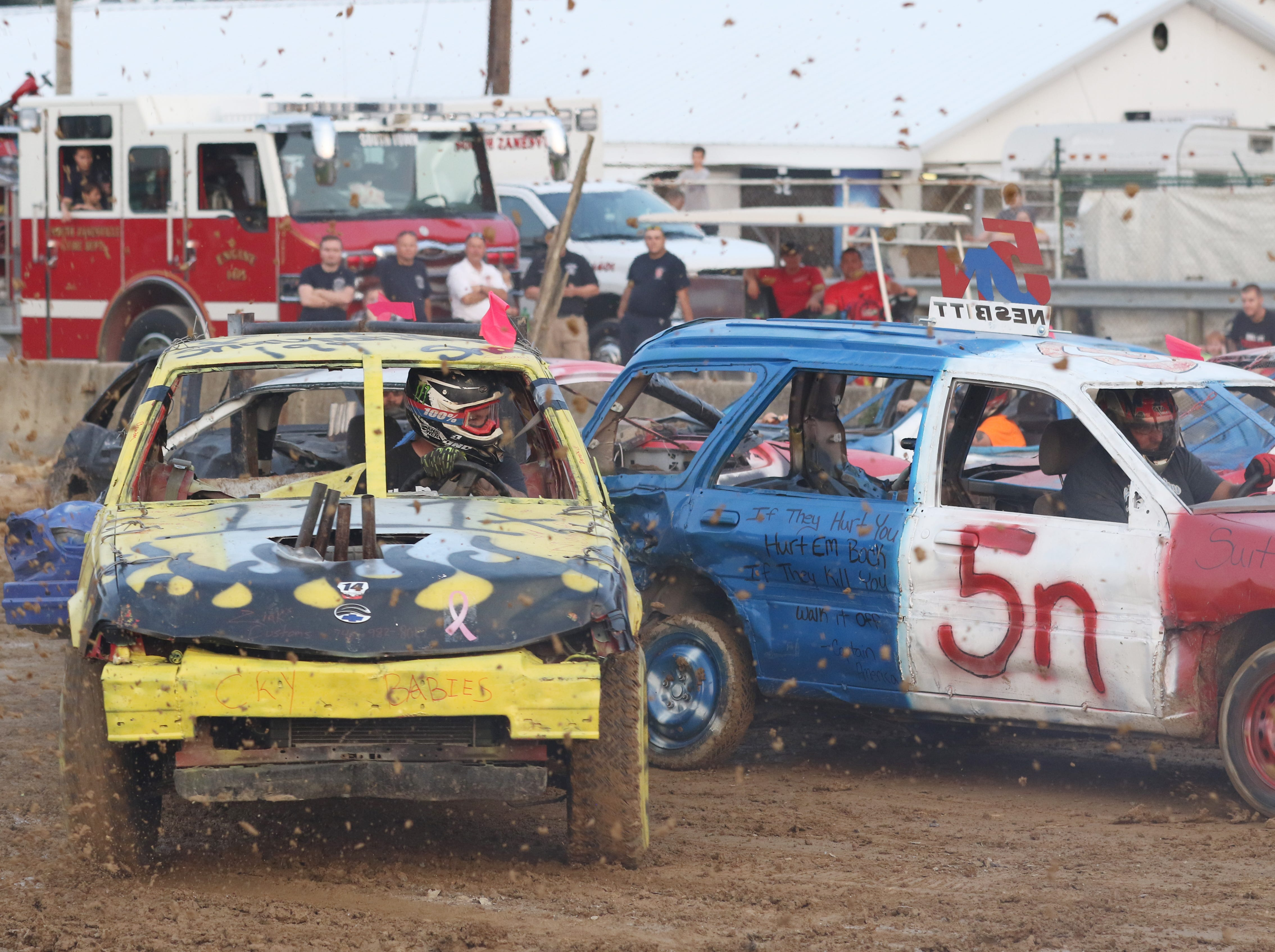 Shawn Savage and Jame Nesbitt in the 5n car collide during the Sarge and Sons Demolition Derby at the Muskingum County Fair on Tuesday.