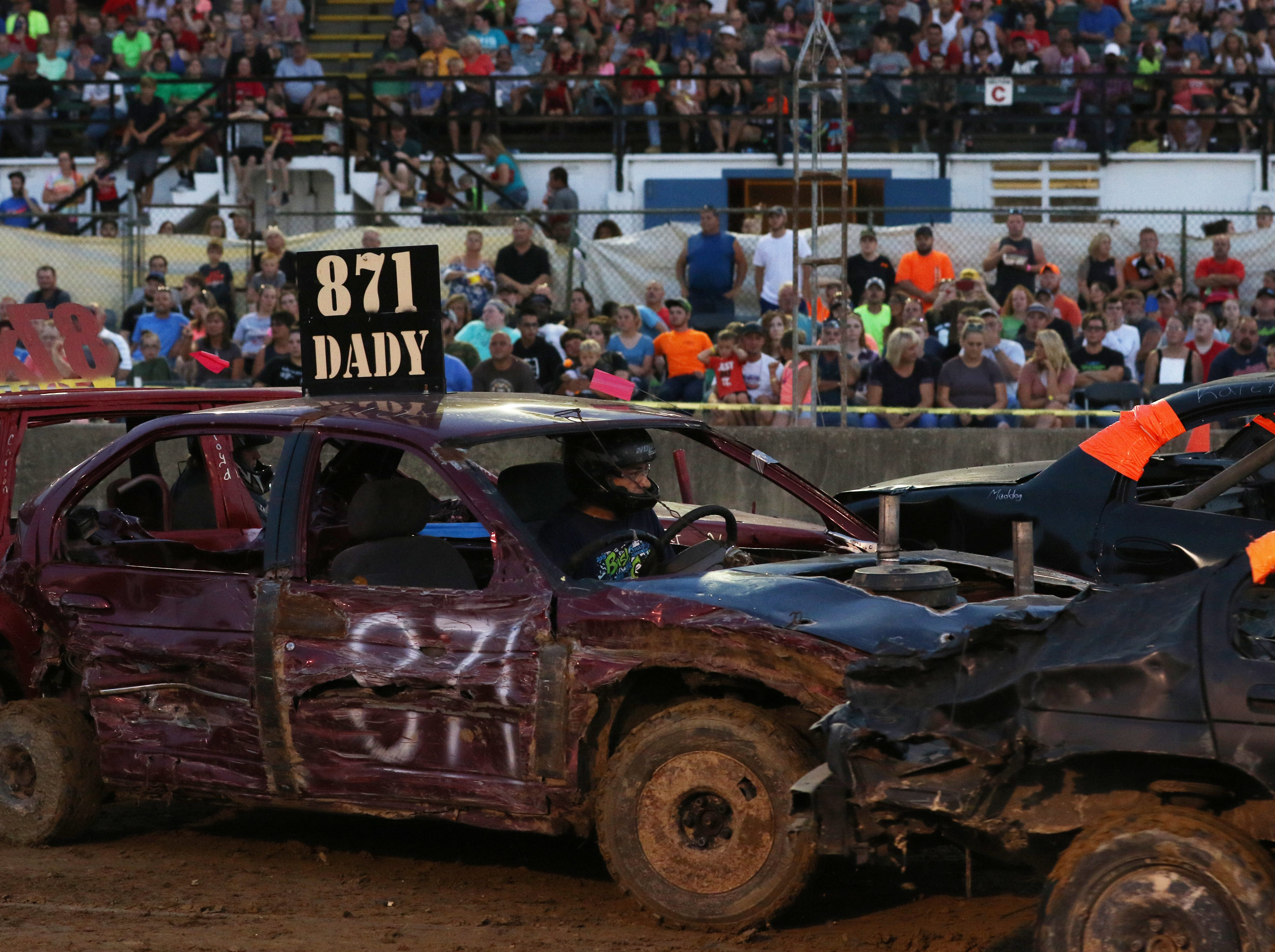 Jim Dady takes aim during the Sarge and Sons Demolition Derby at the Muskingum County Fair on Tuesday.