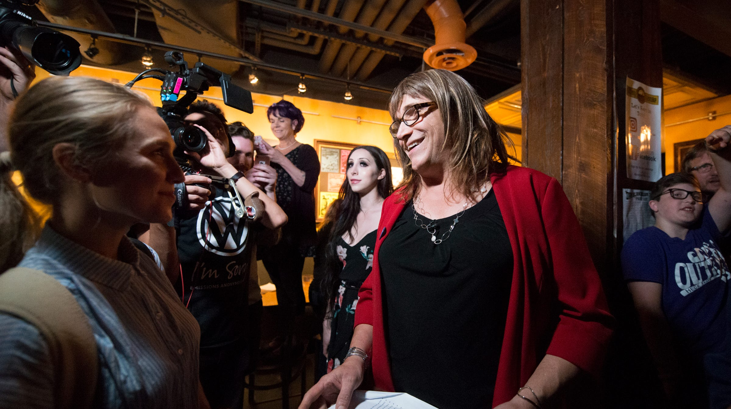 Christine Hallquist talks to reporters after winning the primary during her victory speech during the Primary party for democratic candidate for governor Christine Hallquist at the Skinny Pancake on Tuesday night August 14, 2018 in Burlington. (BRIAN JENKINS/for the FRESS PRESS)