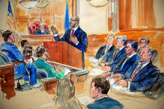 This courtroom sketch depicts Paul Manafort, seated right row second from right, together with his lawyers, the jury, seated left, and the U.S. District Court Judge T.S. Ellis III, back center, listening to Assistant U.S. Attorney Uzo Asonye, standing, during opening arguments in the trial of President Donald Trump's former campaign chairman Manafort's on tax evasion and bank fraud charges. (Dana Verkouteren via AP) ORG XMIT: VADV302