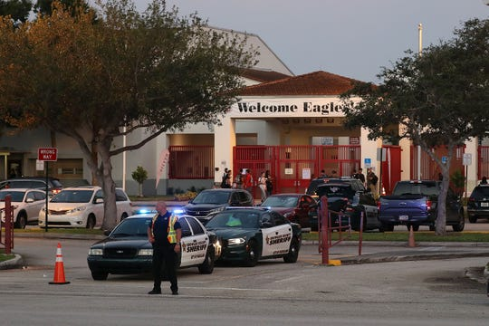 Police keep the campus secure as students arrive at Marjory Stoneman Douglas High School on the first day of school on Aug. 15, 2018 in Parkland, Fla.