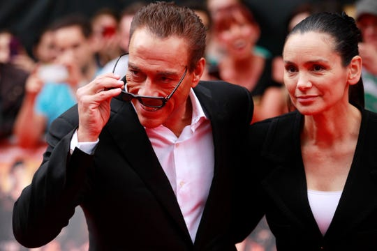 """Jean-Claude Van Damme with his wife Gladys Portugues at the premiere of """"Expendables 2"""" in London in 2012."""