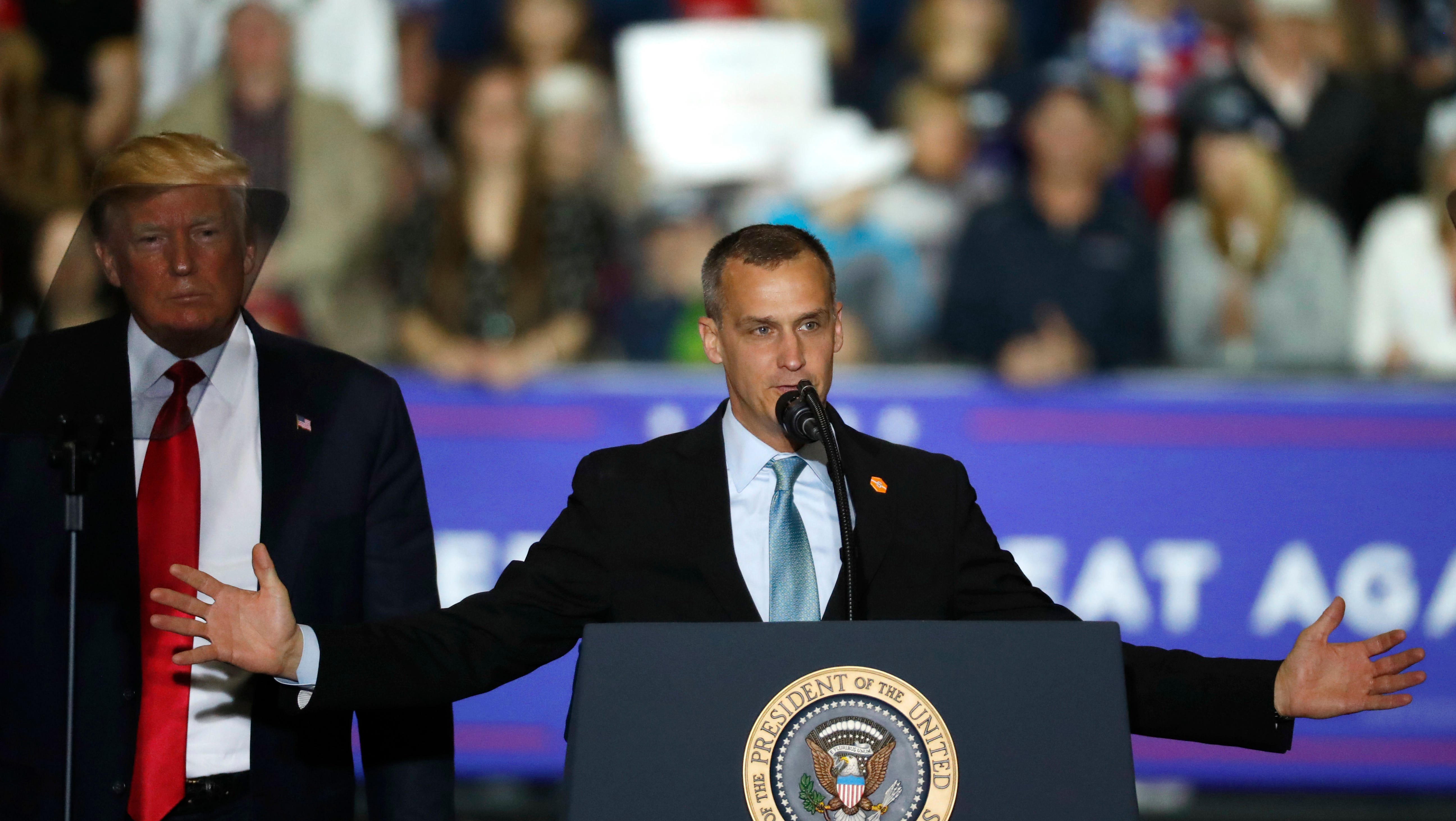 Corey Lewandowski, with President Donald Trump at his side, speaks during a campaign rally in Washington Township, Mich., in April.