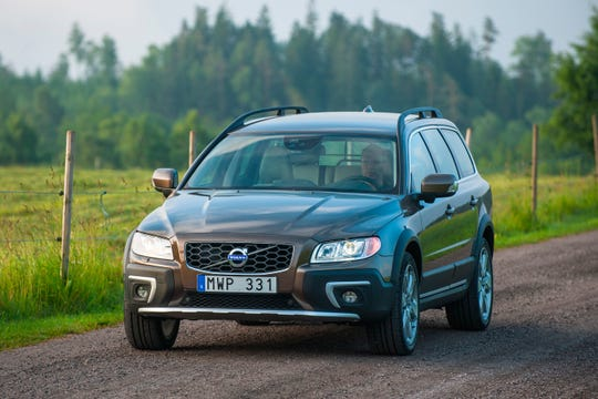 This undated photo provided by Volvo shows the 2016 XC70. To make the versatile XC70, Volvo took its practical and comfortable V70 wagon, raised its ride height and added all-wheel drive. Find a model with either the turbocharged inline-six or the turbocharged inline-five cylinder engine, and you'll have ample power to go with the ample cargo area and Volvo's excellent ergonomics. (Courtesy of Volvo Cars of North America via AP)