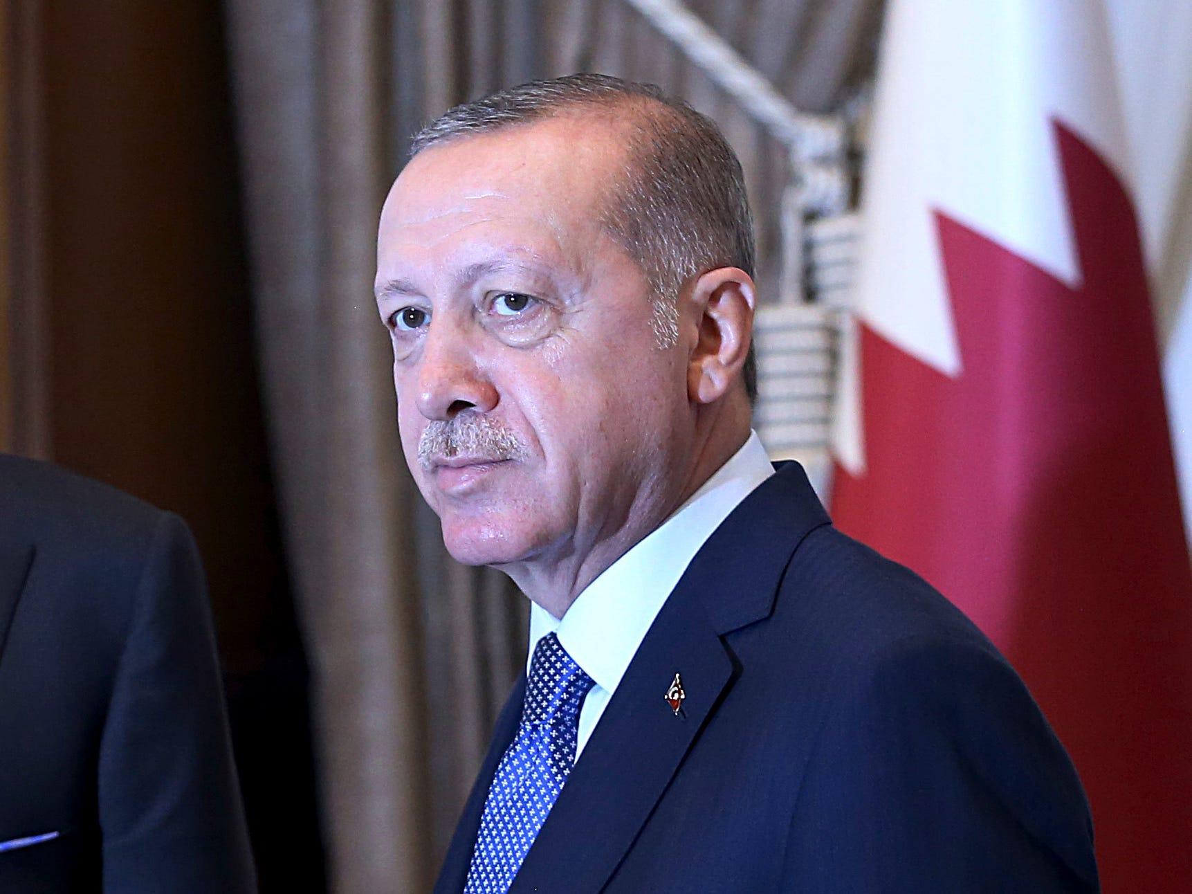 Turkey's President Recep Tayyip Erdogan, meets Qatar's Emir Sheikh Tamim bin Hamad Al Thani prior to their talks at the Presidential Palace in Ankara, Turkey, Aug. 15, 2018.