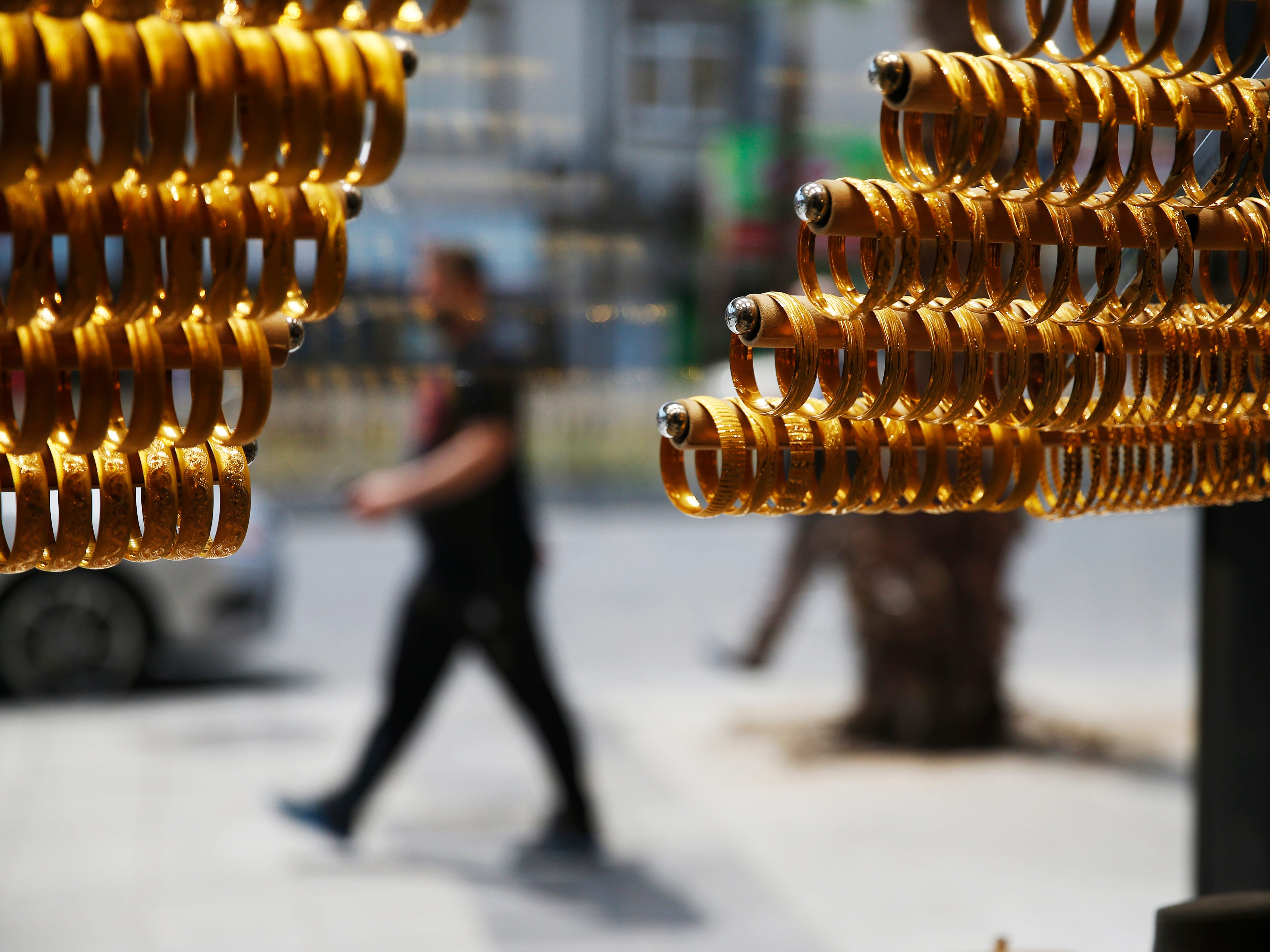 Gold bracelets are displayed at a shop in Istanbul, Aug. 15, 2018. Gold buyers say they have seen an uptick over the past few days of customers selling their shiny coins and goods. The Turkish lira has dropped to record lows in recent weeks, having fallen some 42 percent so far this year.