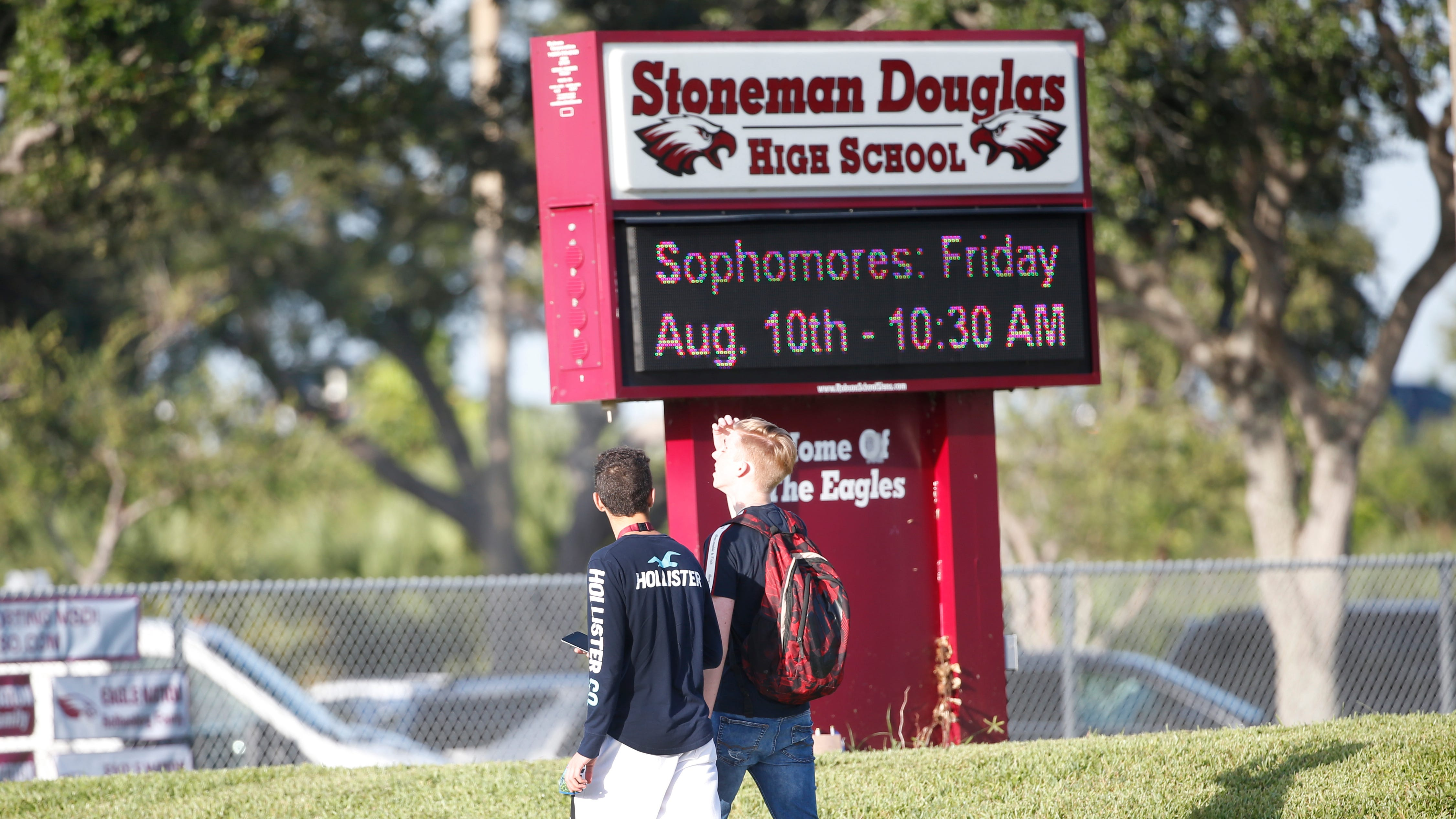 Students walk to class at Marjory Stoneman Douglas High School, Weds., Aug. 15, 2018, in Parkland, Fla. Students at the school returned Wednesday, to a more secure campus as they began their first new school year since a gunman killed 17 people in the freshman building.