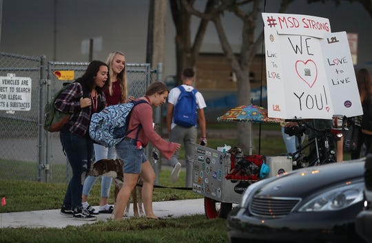 Students walk to Marjory Stoneman Douglas High School on the first day of school on Aug. 15, 2018 in Parkland, Fla.