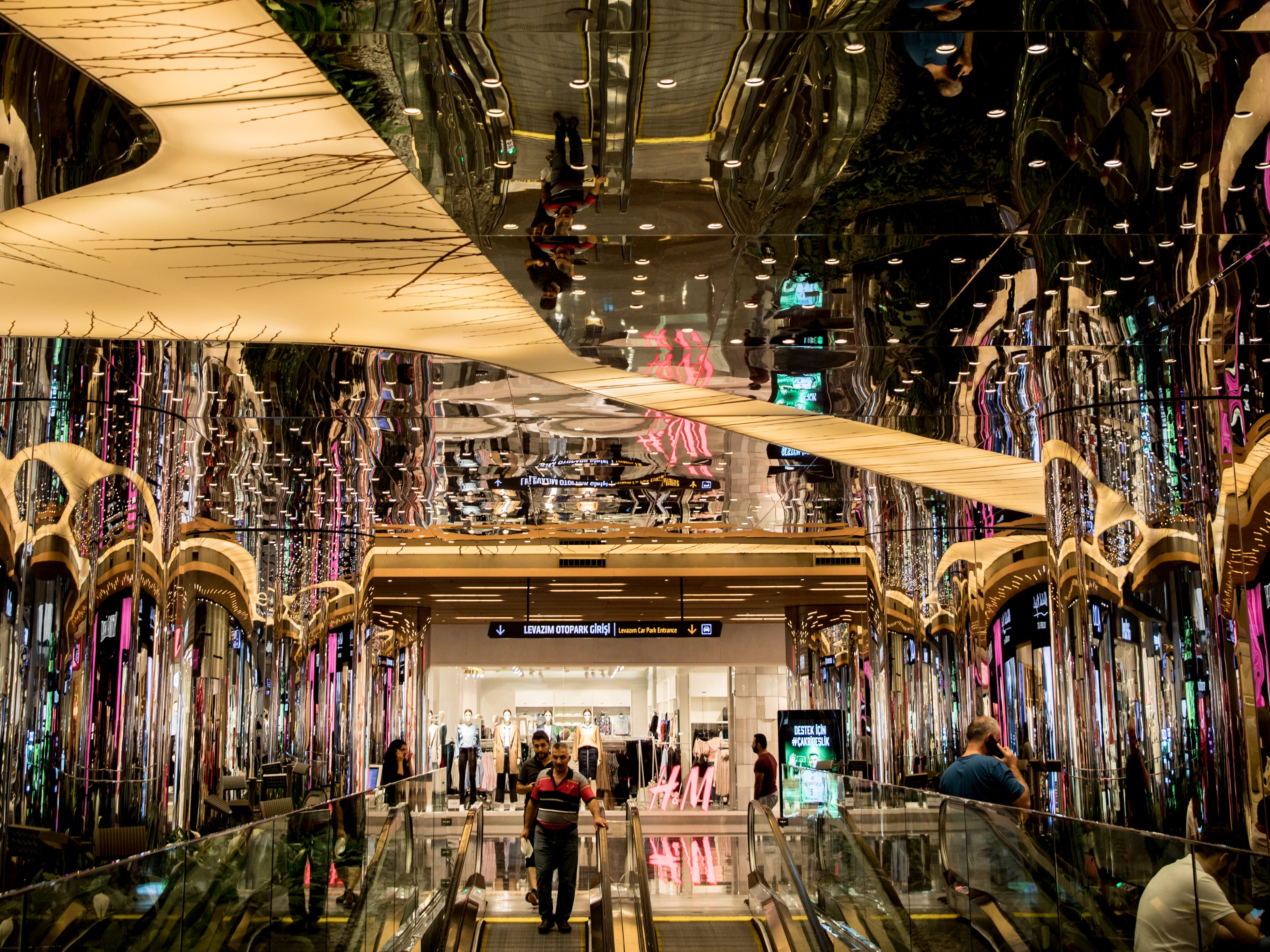 People shop at the Zorlu luxury shopping mall on Aug. 15, 2018 in Istanbul, Turkey.