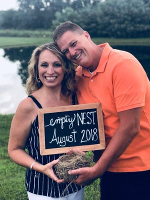 Vicky Piper, left, with her husband, Jeff, pose for a picture honoring their empty nest. The Facebook post generated more than 173,000 reactions.