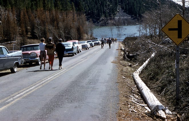 Visitors walk toward the lake created after a magnitude-7.3 earthquake hit near Yellowstone National Park in 1959.