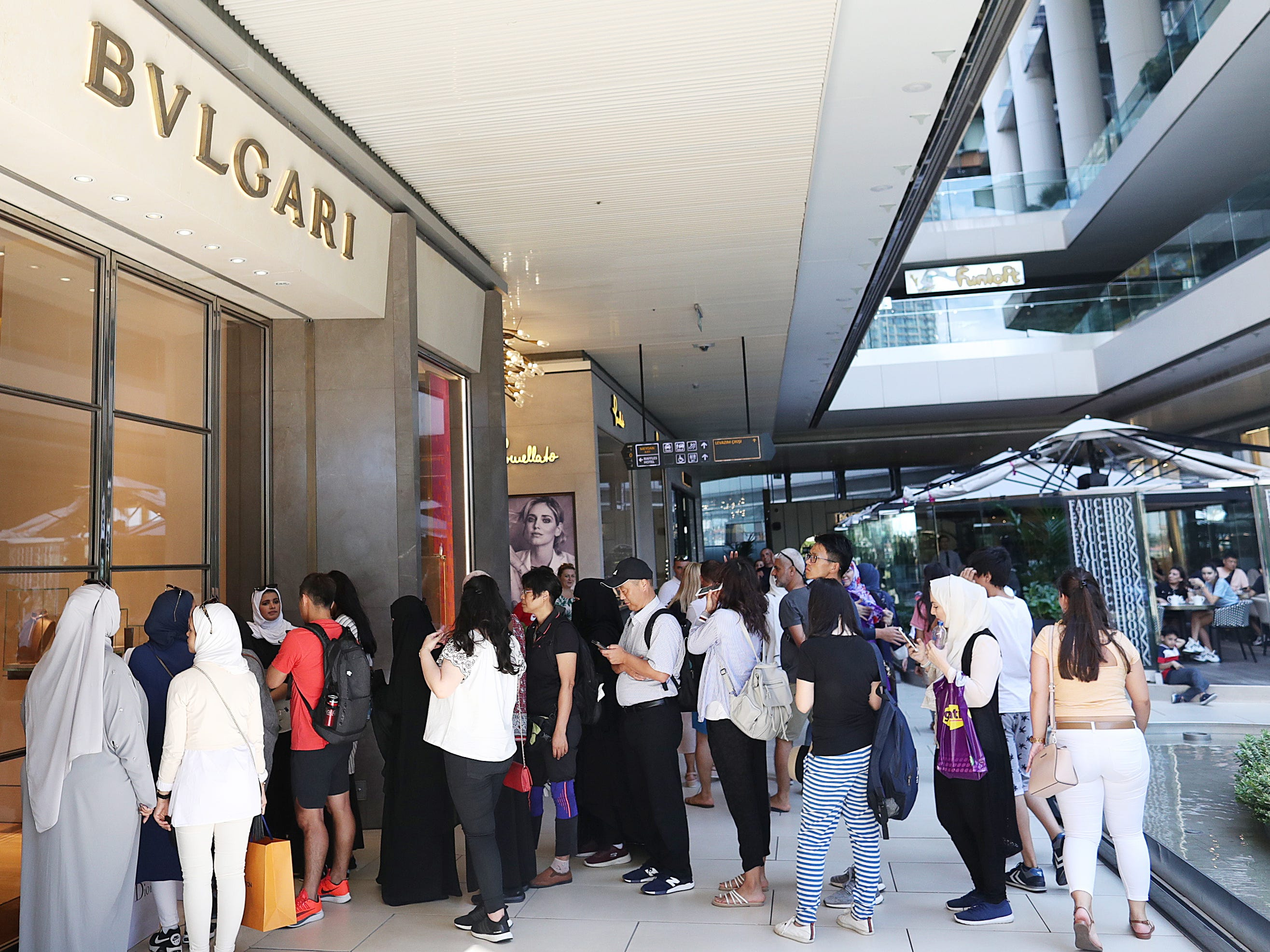 People line up to enter a Bulgari shop in Istanbul, Aug. 15, 2018.