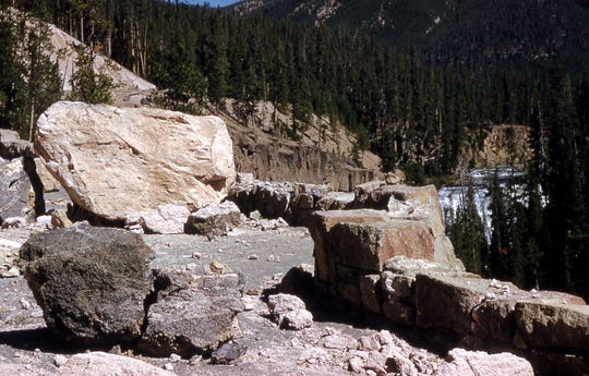 Boulders are seen on a road near Gibbon Falls in Yellowstone National Park after a magnitude-7.3 earthquake struck the area on Aug. 17, 1959.