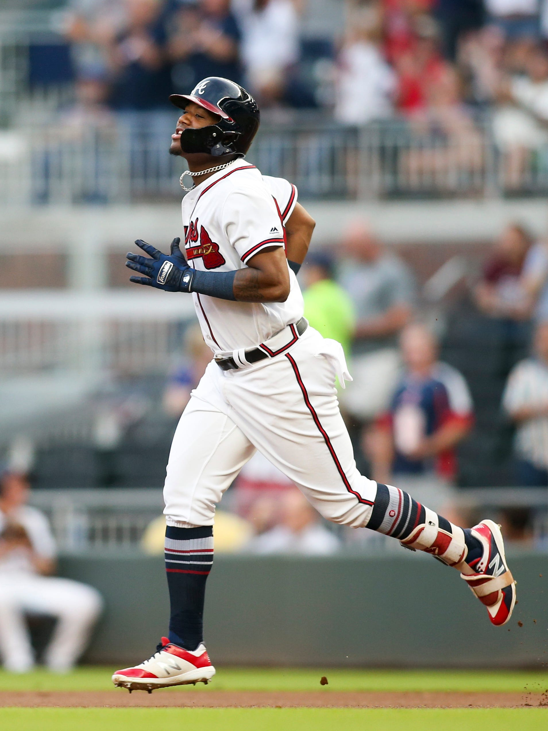 Braves outfielder Ronald Acuna Jr. circles the bases after hitting yet another leadoff home run.