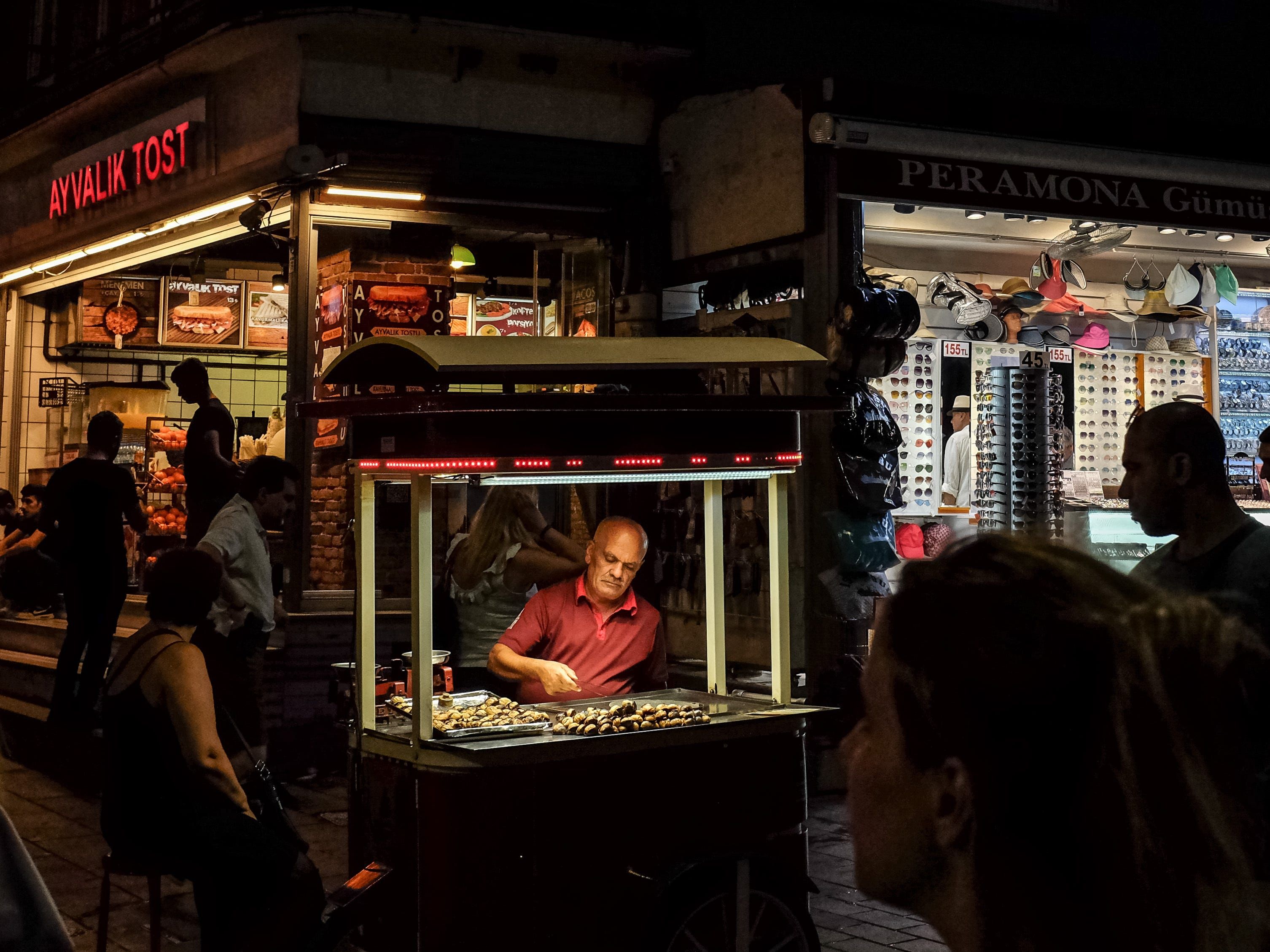 A man sells roasted chestnuts on Aug. 15, 2018 in Istanbul.