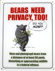 This sign, which is placed in bathroom stalls throughout Great Smoky Mountains National Park, reminds visitors to remain a safe distance from wildlife in a lighthearted way.