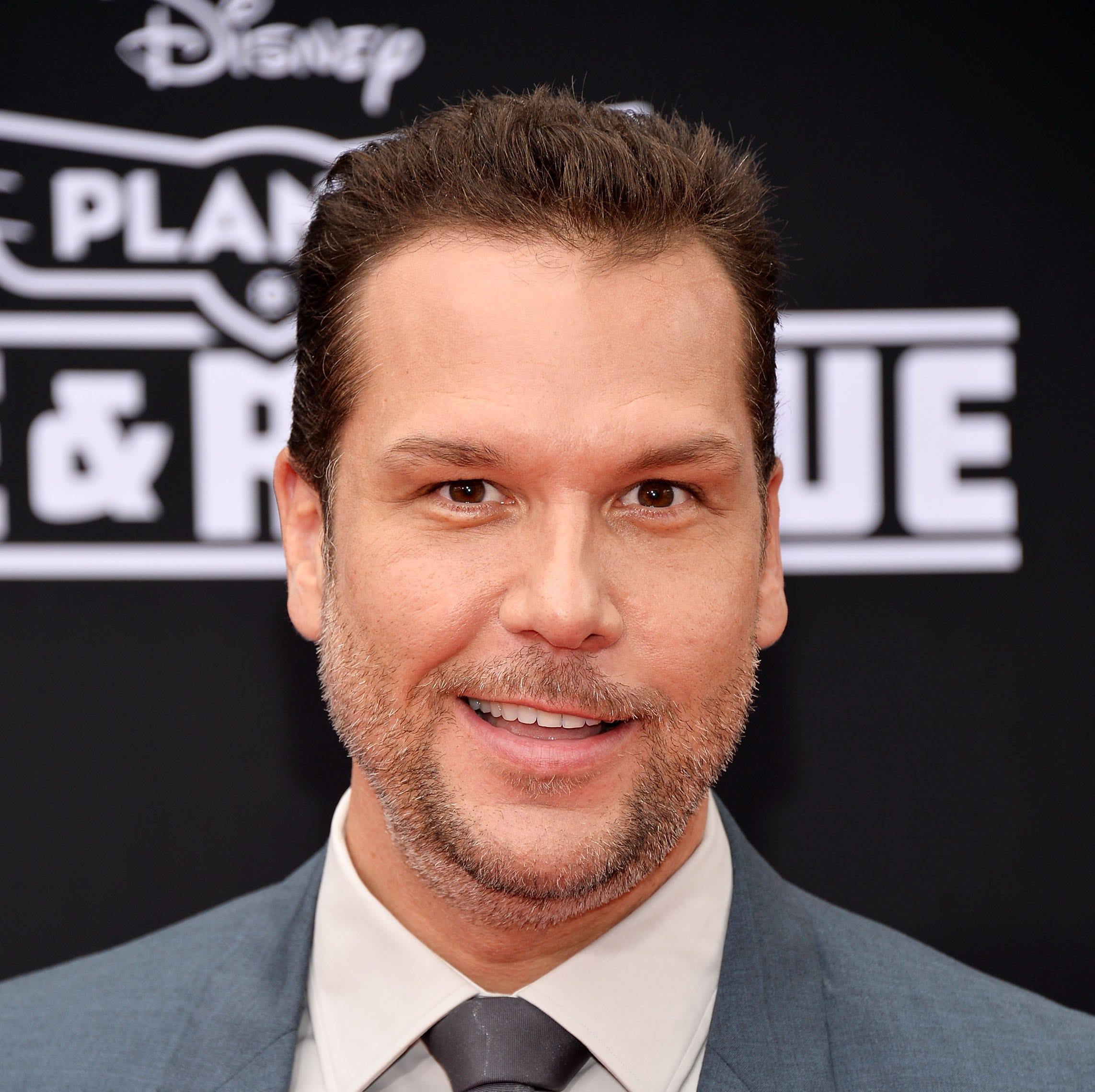 """Actor and comedian Dane Cook arrives at the Los Angeles premiere of Disney's """"Planes: Fire & Rescue"""" on July 15, 2014 in Hollywood."""
