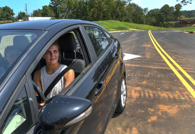 Delaney Rust of Powdersville looks to turn on to Roe Road after leaving a new road to enter the backside of the middle school , recently opened in Powdersville. Officials are hoping it will help with better traffic flow.