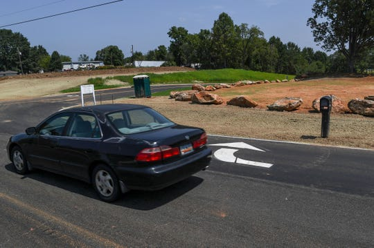A car drives along Roe Road, past the new road to enter the backside of Powdersville Middle School, and recently opened in Powdersville.
