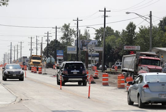 Businesses line Oneida Street where heavy construction is underway on the border of Appleton and Fox Crossing.