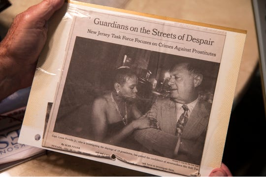 "Portella holds a 1998 newspaper clip from The New York Times featuring his relationship with a prostitute turned informant nicknamed ""Soft Touch."""