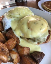 An order of crab cake Benedict at The Starving Artist in Ocean Grove.