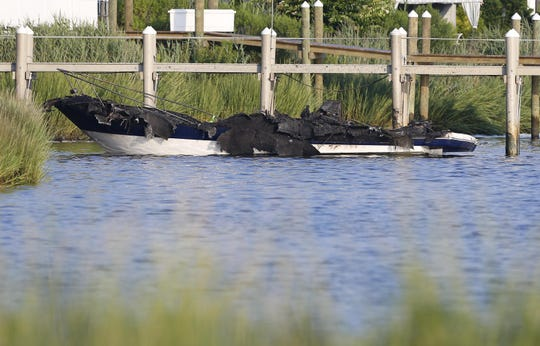 Photo of 30ft Chaparral boat destroyed by fire at Pattern Point Yacht Club. Long Branch,NJ. Wednesday, August 15,2018. Noah K. Murray-Correspondent Asbury Park Press