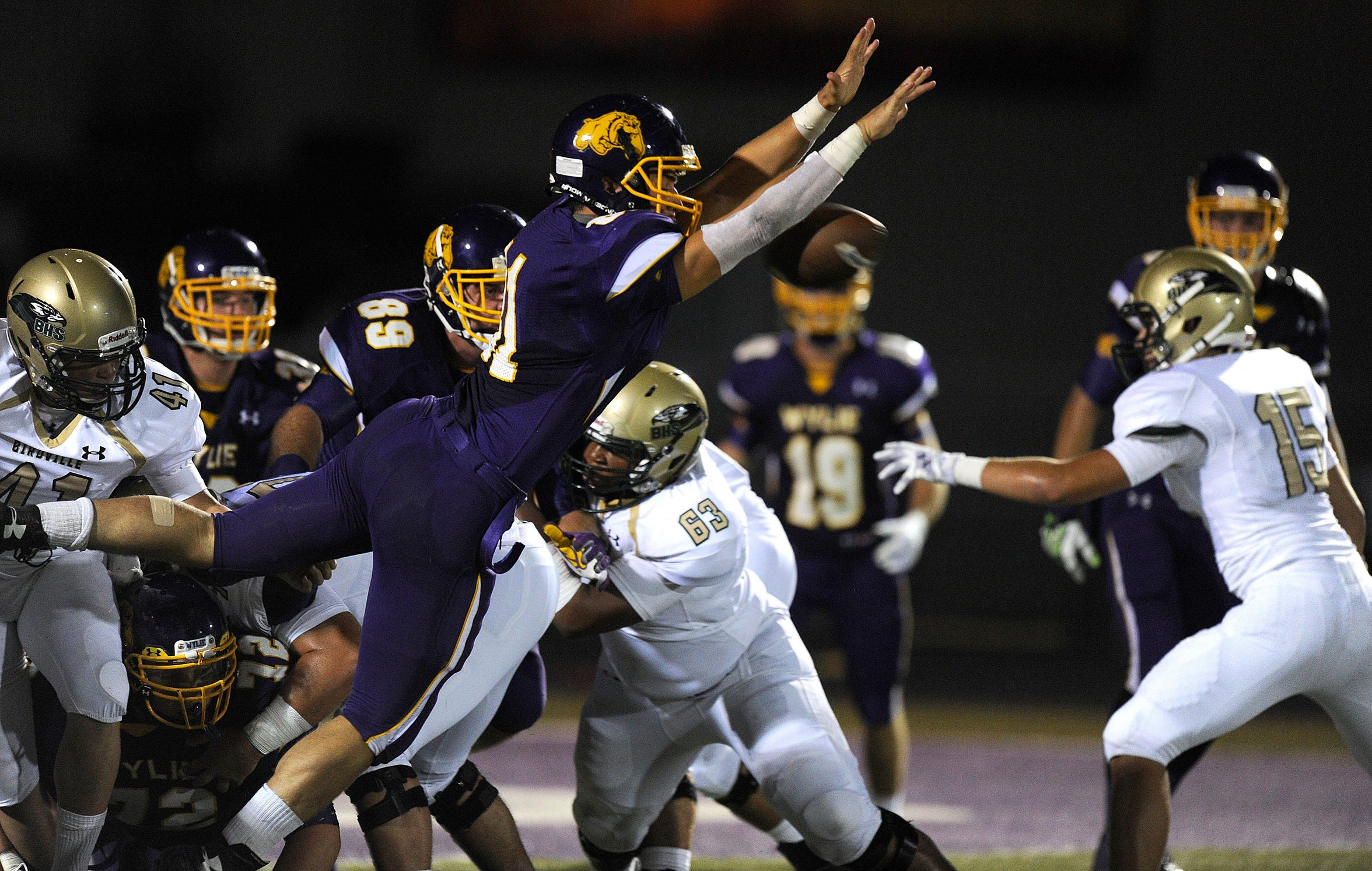 Former Wylie linebacker Clay Johnston (81) blocks a PAT attempt during a 2014 win against Birdville. Johnston is set to begin his junior year at Baylor this season when ACU travels to Waco on Saturday, Sept. 1, 2018.