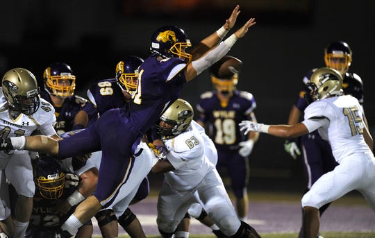 Former Wylie linebacker Clay Johnston (81) blocks a PAT attempt during a 2014 win against Birdville. Johnston was selected in the seventh round of the NFL Draft by the Los Angeles Rams.