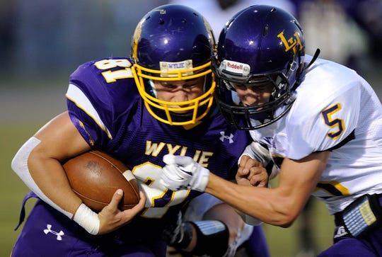 Former Wylie running back/linebacker Clay Johnston runs the ball against Liberty Hill during the 2014 season. Johnston became the third football player from Wylie drafted when the Los Angeles Rams selected him in the seventh round on Saturday.