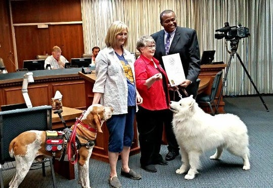 Abilene Mayor Anthony Williams poses for a photo at the Aug. 9, 2018, City Council meeting after issuing a proclamation in honor of Responsible Dog Ownership Day.