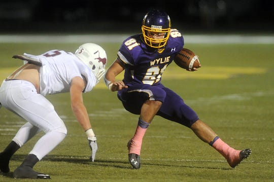 Former Wylie standout Clay Johnston runs the ball against Brownwood during the 2014 season. Johnston was a two-way player for the Bulldogs earning All-State honors as a running back and linebacker.