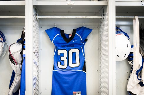 Markell Lipscomb's Polk County high school football jersey is displayed in his locker in the field house in his memory after he was killed in a car accident in July. Lipscomb was 17.