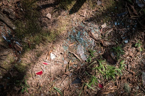 Debris at the site where Markell Lipscomb, 17, a rising senior at Polk County high school and a member of the football team, was killed in a car accident in July.