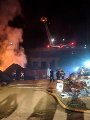 Firefighters work to extinguish a fire at Biltmore Iron and Metal Company.