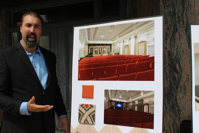 Jeff Breedlove, director of community affairs for the Church of Scientology in Battle Creek, shows off a rendering of the ballroom and worship center that will be inside the renovated Hart Hotel.
