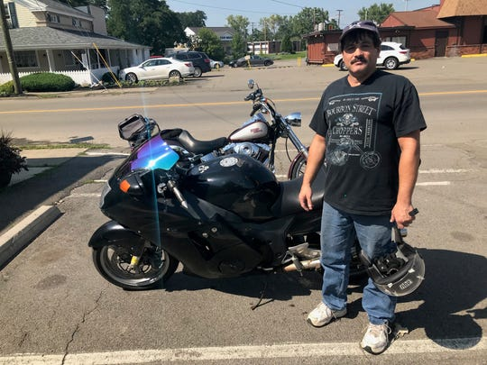 Tracy Henshaw of Elmira Heights stands with his his 1998 Honda CBR 1100XX.