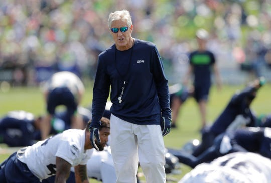 Seahawks coach Pete Carroll has carefully instructed his players this summer about new league rules on initiating contact with their helmets.