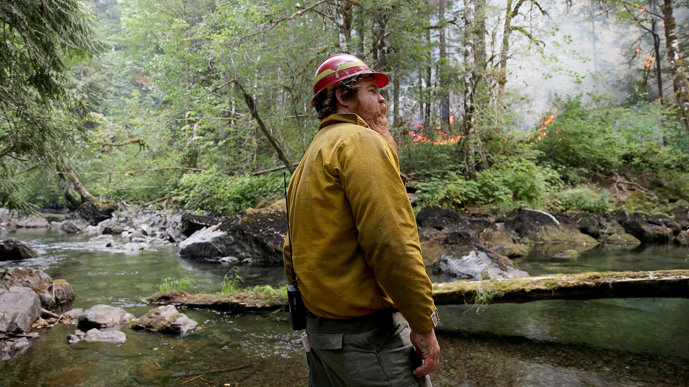 Ben Dean, a U.S. Forest Service firefighter from Quilcene, monitors the Maple Fire on Wednesday.