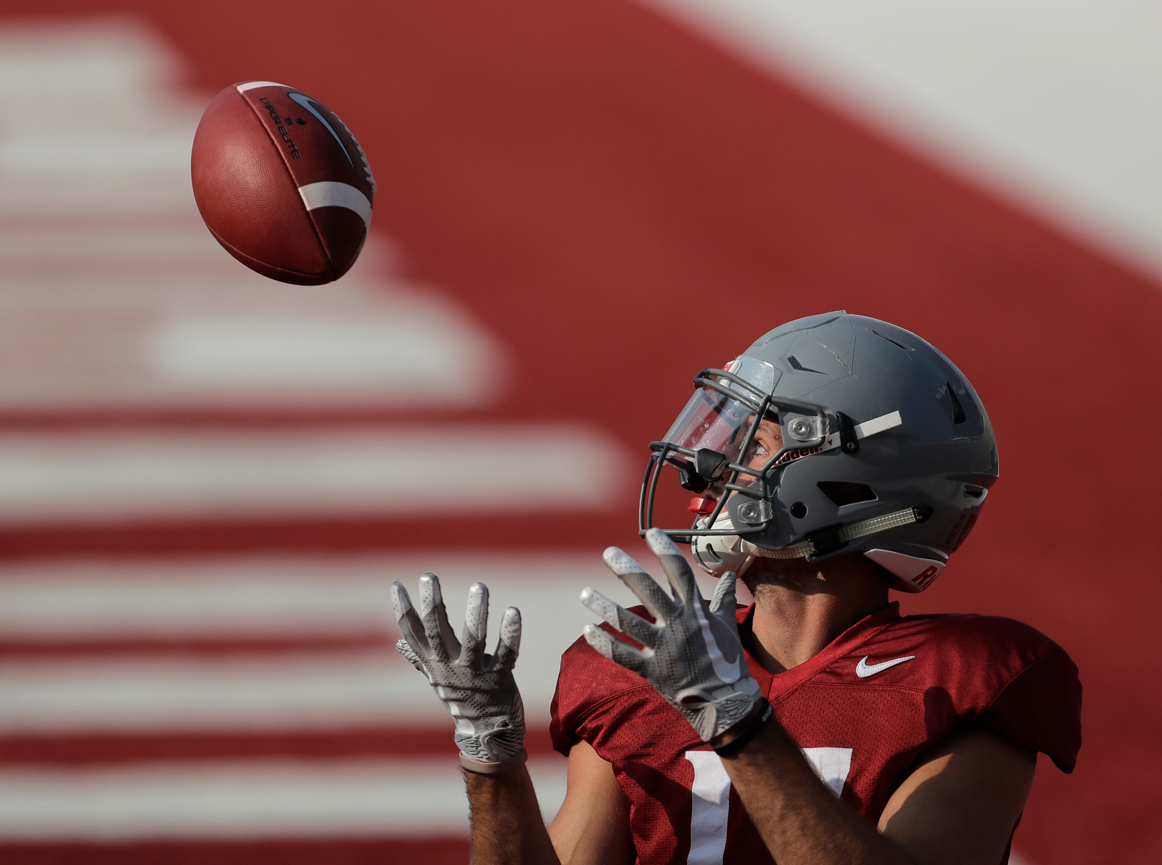 Washington State wide receiver Kyle Sweet makes a catch in the end zone during Thursday's practice.
